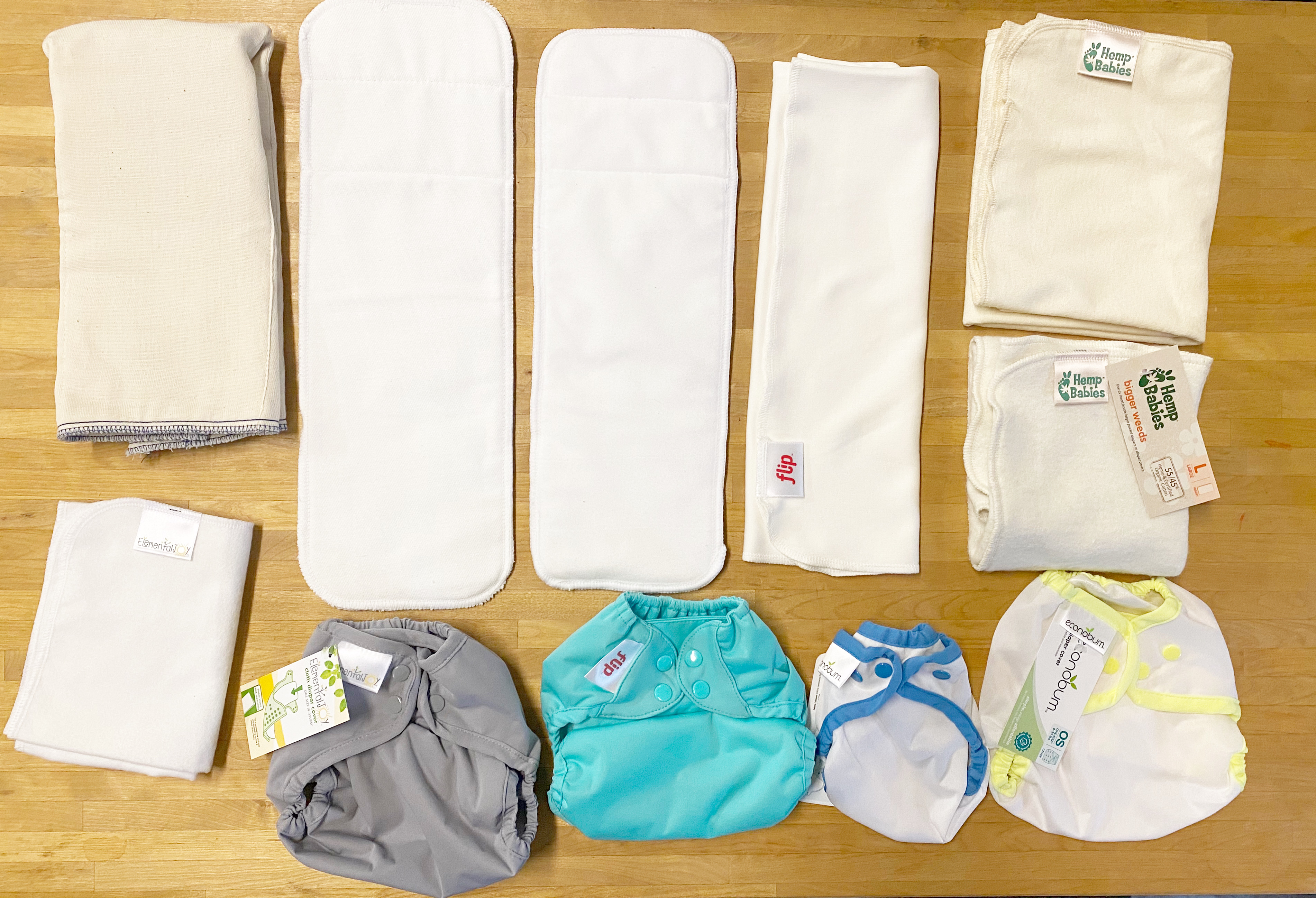 Choosing an insert to use inside a cloth diaper cover. #clothdiapers #Flipdiapers #ElementalJoy #Econobum #prefolds #flats